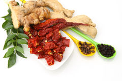 Curry leaves,ginger and red chillies Royalty Free Stock Image