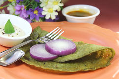 Curry leaves green dosa Stock Photography