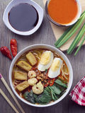 Curry Noodle with hard boiled egg, tofu, shrimp, and vegetable. Tasty asian dish, curry noodle with hard boiled egg, tofu, shrimp, and vegetable Royalty Free Stock Images