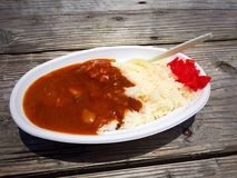 Curry och ris, strandmat Arkivfoto