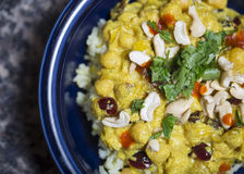 Curry over rice. A blue bowl of delicious chickpea curry over rice Stock Photos