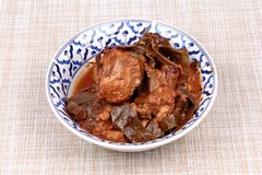 Curry pork with Chamuang Garcinia cowa leaves,Local Thai food stock image