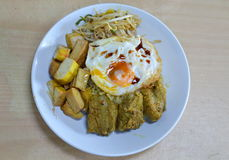 Curry pork rib and tofu topping fried egg on rice Royalty Free Stock Image