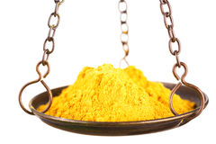 Curry powder in a balance scale Royalty Free Stock Images