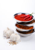 Curry powder in bowl stack with chili ,garlic,pepper ingredients Stock Image