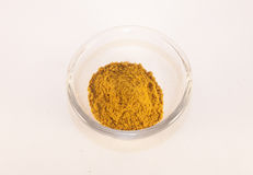 Curry powder. Glass full of curry powder, isolated on white background Stock Photos