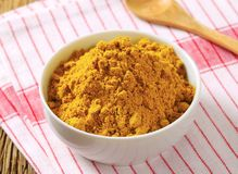 Curry powder. Heap of curry powder in a bowl Royalty Free Stock Photos