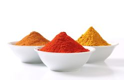 Curry powder, paprika and ground cinnamon Stock Photo