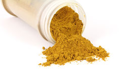 Curry powder spilling Stock Image