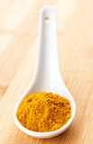 Curry powder in spoon Stock Photos