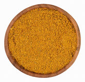 Curry powder  in a wooden bowl on a white Royalty Free Stock Photo