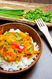 Curry with prawns, vegetables and chives Stock Images