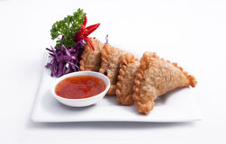 Curry puff, Thai entree, Appetizer. Thai popular entree,curry puff and sweet chili sauce Royalty Free Stock Photos