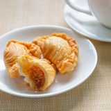Curry puff on white plate stock photo