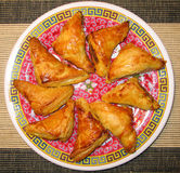 Curry Puffs. Freshly cooked curry puffs on a plate Stock Image