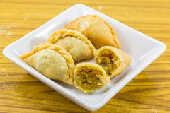 Curry puffs on white plate Royalty Free Stock Images