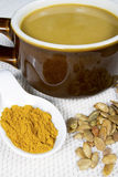 Curry Pumpkin Soup in Crockery Stock Image