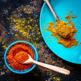 Curry and red pepper on a blue plate Stock Photo