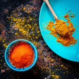 Curry and red pepper on a blue plate Stock Photography