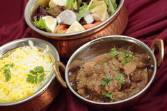 Curry and salad in bowls Stock Photos