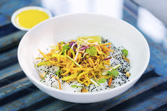 Curry sauce vegetable salad with noodles and sesame Royalty Free Stock Photos