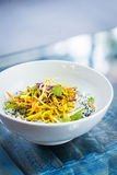 Curry sauce vegetable salad with noodles and sesame Stock Photos