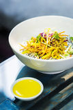 Curry sauce vegetable salad with noodles and sesame Stock Image