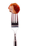 Curry sausage on a fork Stock Image