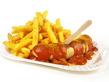 Curry Sausage with Sauce. And French Fries stock photos