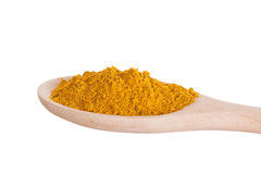 Curry seasoning in a wooden spoon Stock Images
