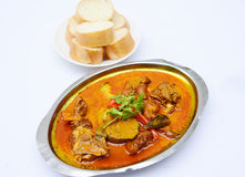 Curry soup of goat meat with bread on white background Royalty Free Stock Photography
