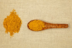 Curry spice. Curry spice on bamboo spoon - top view Royalty Free Stock Photography