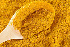 Curry spice with wooden spoon Royalty Free Stock Images