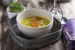 Curry sweet potato soup with shrimp on wooden table Stock Photos