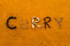 Curry written with spices Royalty Free Stock Photography