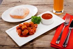 Curry wurst spicy sausage with curry and ketchup Stock Images