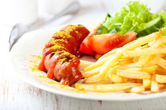 Currywurst with french fries Royalty Free Stock Images