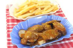 Currywurst with french fries Royalty Free Stock Photo