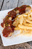 Currywurst with French Fries Stock Photos