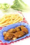 Currywurst with french fries with salad Royalty Free Stock Photo