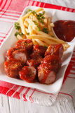 Currywurst and fries close-up on a plate. vertical Stock Photos