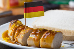 Currywurst with german flag. A currywurst with german flag stock photos