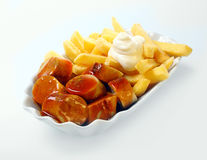 Currywurst with golden potato chips Royalty Free Stock Image