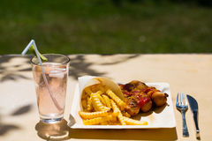 Currywurst and pommes on recyclable dishes Royalty Free Stock Photo