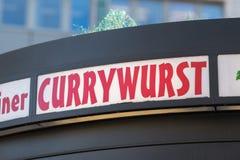 Currywurst restaurangsignage arkivfoto
