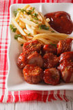 Currywurst sausage with french fries close-up. vertical Royalty Free Stock Photography