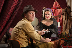 Cursed Man with Fortune Teller. Man with fortune teller worried about bad luck Royalty Free Stock Image