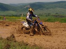 Curseur de motocross Photographie stock