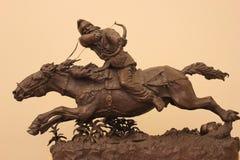 Curseur sur un cheval Photo stock