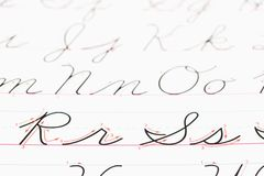 Cursive handwriting. Close up of cursive handwriting practice page royalty free stock image